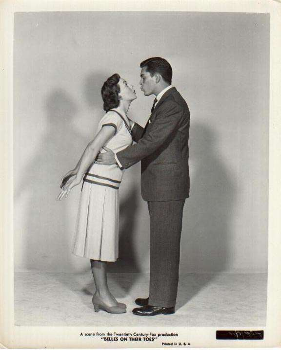 Belles On Their Toes Jeffrey Hunter Jeanne Crain kissing