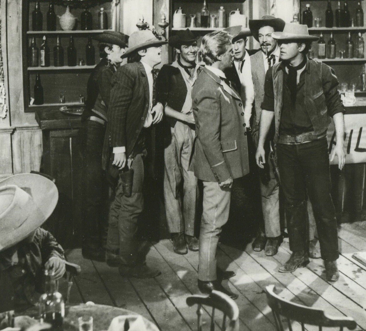 The Christmas Kid  Jeffrey Hunter  In a group at the bar